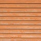 Vecchie plance di legno naturali del recinto, struttura vicina di legno del bordo, fondo bruno-rossastro leggero di sovrapposizio fotografie stock