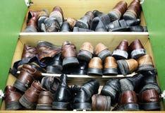 Vecchie scarpe Immagini Stock