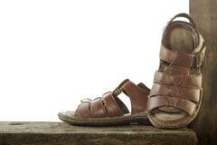 Vecchie scarpe di marrone del tessuto isolate Fotografia Stock Libera da Diritti
