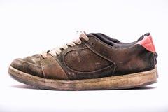 Vecchie scarpe irregolari Immagini Stock