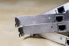 Vecchie schede di rete per i desktop computer Schede di rete con rj44 Fotografie Stock Libere da Diritti