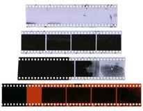 Vecchie, strisce di pellicola usate, polverose e graffiate della celluloide Fotografie Stock Libere da Diritti