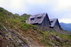Vecchie tettoie della montagna Fotografia Stock