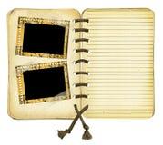 Vecchio album con i blocchi per grafici su priorità bassa isolata Fotografia Stock Libera da Diritti