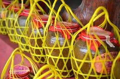 Vecchio barattolo del liquore in Tailandia Fotografia Stock