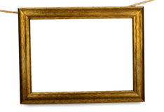 Vecchio blocco per grafici di legno che appende su una corda Immagine Stock Libera da Diritti
