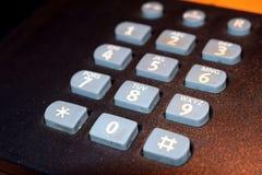 Vecchio bottone grigio del telefono Immagine Stock