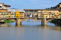 Vecchio Bridge, Florence , Italy. Vecchio Bridge's backside, Florence , Italy, with rower passing by Royalty Free Stock Photography