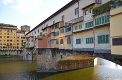 Ponte Vecchio - Florence - Italy. The Vecchio Bridge (Ponte Vecchio) is the oldest and most famous bridge in Florence Italy. It is a Medieval stone closed Stock Images