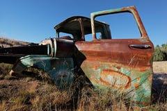 Vecchio camioncino arrugginito Fotografia Stock
