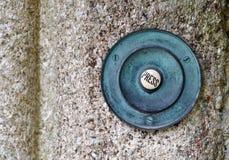 Vecchio campanello per porte di rame Fotografia Stock