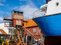 Vecchio cantiere navale arrugginito in Tromso Norvegia Immagini Stock