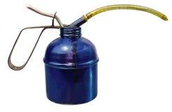 Vecchio contenitore blu dell'olio con il percorso di residuo della potatura meccanica Fotografia Stock Libera da Diritti
