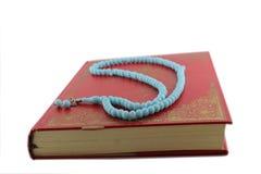 Vecchio Corano chiuso e Padrenostro Fotografia Stock