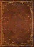 Vecchio cuoio con la decorazione dorata Fotografie Stock