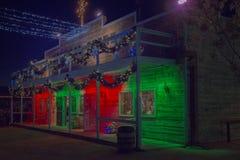 Vecchio deposito di selvaggi West decorato con i colori di festa di Natale Fotografie Stock