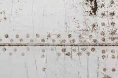 Vecchio dettaglio di alluminio di un æreo militare, corrosione superficiale del fondo Immagini Stock