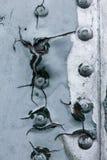 Vecchio dettaglio dipinto di un æreo militare, corrosione superficiale del fondo del metallo Immagine Stock
