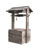 Vecchio di legno pozzo d'acqua con il tetto isolato. Immagine Stock Libera da Diritti