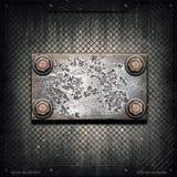 Vecchio di piastra metallica sulla parete metallica Fotografie Stock