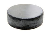 Vecchio disco di gomma di hokey nero Fotografie Stock Libere da Diritti