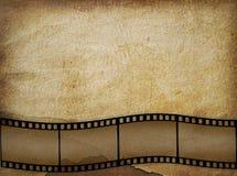 Vecchio documento nello stile del grunge con filmstrip Fotografie Stock