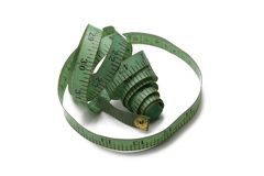 Vecchio e nastro di misurazione utilizzato verde del sarto fotografia stock libera da diritti