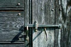 Vecchio fermo di porta del ferro Fotografia Stock Libera da Diritti