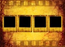 Vecchio filmstrip sul documento Immagine Stock