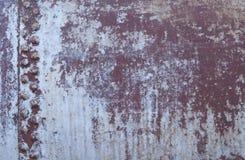 Vecchio fondo arrugginito rivettato del metallo fotografia stock libera da diritti