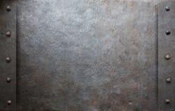 Vecchio fondo del metallo con i ribattini Fotografia Stock