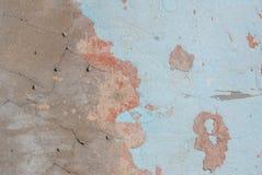Vecchio gesso scheggiato sul muro di cemento, struttura del fondo Fotografie Stock Libere da Diritti