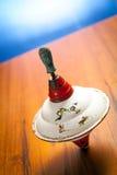 Vecchio giocattolo della huming-parte superiore Fotografia Stock