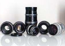 Vecchio insieme manuale dell'attrezzatura delle lenti Fotografie Stock Libere da Diritti