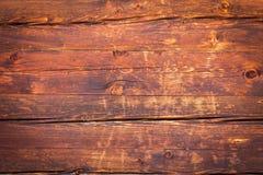 Vecchio legno ad una capanna della montagna Immagine Stock