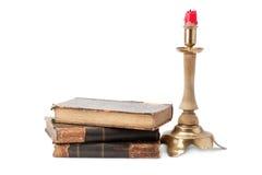 Vecchio libro e candeliere Fotografia Stock