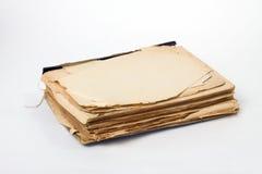 Vecchio libro su priorità bassa bianca Fotografia Stock