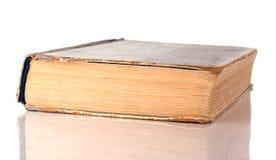 Vecchio libro su una priorità bassa bianca Fotografia Stock