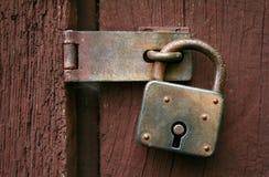 Vecchio lucchetto arrugginito Fotografia Stock