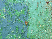 Vecchio metallo arrugginito con il fondo blu tre della pittura immagine stock