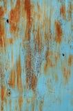 Vecchio metallo arrugginito del fondo e di struttura con pittura blu Immagini Stock