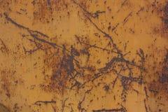 vecchio metallo arrugginito nel fondo marrone di colore Immagine Stock