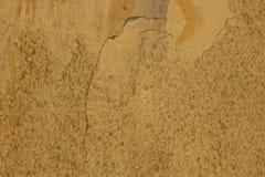 Vecchio muro di cemento incrinato dipinto Priorità bassa del Brown struttura della parete uccisa fotografie stock