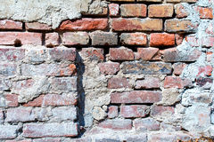 Vecchio muro di mattoni rosso nocivo - fondo Fotografia Stock