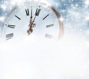 Vecchio orologio con le stelle ed i fiocchi di neve Fotografie Stock Libere da Diritti