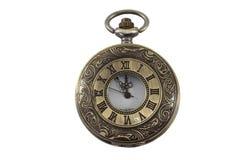Vecchio orologio sulla terra della parte posteriore di bianco Immagine Stock