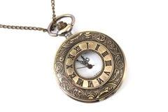 Vecchio orologio sulla terra della parte posteriore di bianco Fotografia Stock Libera da Diritti