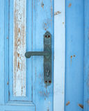 Vecchio particolare blu del portello del grunge, maniglia Immagine Stock