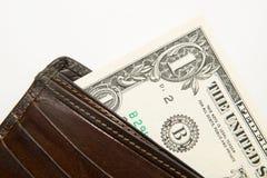 Vecchio portafoglio con le banconote dei dollari americani dentro Immagini Stock