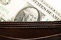 Vecchio portafoglio con le banconote dei dollari americani dentro Fotografie Stock Libere da Diritti